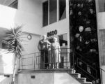 Forman Brown and his mother in front of their new apartment at 8600 Rugby Drive in 1958.