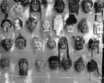Display of masks exhibited by Harry Burnett at the Pasadena Art Fair in 1958.