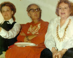 Dorothy Neumann and Elsa Lanchester sitting on a couch with another woman at the Turnabouters'...