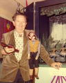 Harry Burnett holding his Simon Legree puppet.