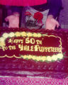 "A cake with the words, ""Happy 50th to the Yale Puppeteers."""