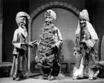 Three marionettes of men from India, created for Howard Mitchell by Harry Burnett.