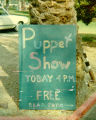 Sign announcing Harry Burnett's puppet show at Claremont Memorial Park in 1967.