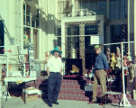 Harry Burnett and Forman Brown selling puppets at a sidewalk sale in Westwood Village.