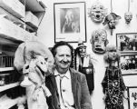Harry Burnett with his puppets and masks in his workshop.