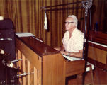 Forman Brown playing the piano, with a microphone hung in front of him, perhaps in a recording...
