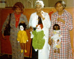 Three senior citizen women holding marionettes they have made in a class given by Harry Burnett.