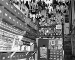 Turnabout Theatre puppet workroom, with boxes and jars labeled and puppets hanging from the...