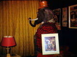 Mr. Poggins, the elephant from Tommy Turnabout's Circus, standing in Richard Brandon's office at...