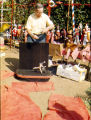 Harry Burnett handling a weight-lifter puppet at his puppet yard sale.