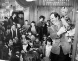 Harry Burnett, Yale Puppeteer, presenting his puppet to children in Lytton Center Auditorium in...