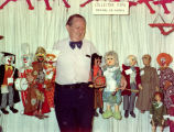 "Harry Burnett with numerous ""Collector Items--Original H. B. Puppets"" on sale in his..."