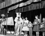 Children onstage holding letters at Tommy Turnabout's Circus.