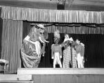 Mr. Poggins the elephant, a clown and two children cast members onstage at Tommy Turnabout's...