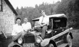 Harry Burnett, Bob Bromley and Richard Brandon seated on a car at The Plantation, Forman Brown's...