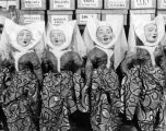 A row of puppets in medeival costume in the Turnabout Theatre workshop in 1947.