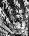 A view of numerous puppets hanging from the ceiling backstage at Turnabout Theatre in the puppet...