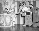 Tommy Turnabout, Harry Burnett as Bobolino the clown, an elephant, and Dorothy Neumann in costume,...