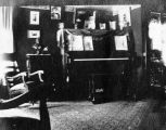 Interior view of Forman Brown's childhood home in Otsego, Michigan, showing the piano on which he...