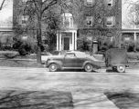The Yale Puppeteers' car and trailer outside the University Club of Evanston, Illinois, where they...