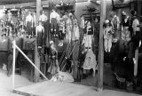 Numerous puppets hanging from racks in Turnabout Theatre workshop.