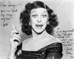 "Portrait of a female impersonator of movie actress Bette Davis, who signed it, ""Dear Harry,..."