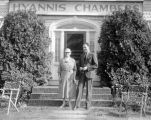 Forman Brown standing with a woman outside a building, Hyannis Chambers, while on a puppet tour.