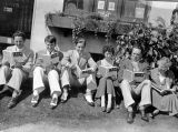 The Turnabouters, Mrs. Brooks and others sit on the lawn outside her book shop in Beverly Hills,...