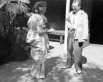 Elsa Lanchester in her Gazebo number dress meeting Bill Tostevin, Turnabout Theatre's publicity...