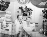 Two women working in the nut shop at Farmers Market in 1946.