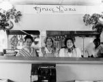 Four women behind the counter of the Dana shop at Farmers Market in 1946.