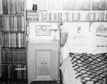 Corner of Harry Burnett's room at Turnabout Theatre in 1946, showing bed and music albums.