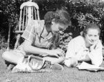 Dorothy Neumann and Elsa Lanchester on the grass at Elsa Lanchester's Palos Verdes home in 1946.