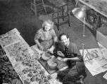 Mrs. Wilkes and Harry Burnett painting puppet bodies at Turnabout Theatre in 1946.