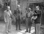 Gordon Amende, Forman Brown, Pompeo and Richard Brandon standing at Forman Brown's house in 1947. ...