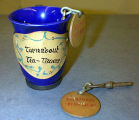 "An ""Turnabout Old Timer"" cup and three keys, issued to Turnabout Theatre regulars for..."