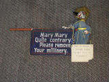 "Puppet-like character and sign that opened every performance at Turnabout Theatre:  ""Mary,..."